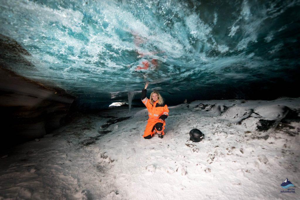 Girl inside natural ice cave in Langjokull, Iceland