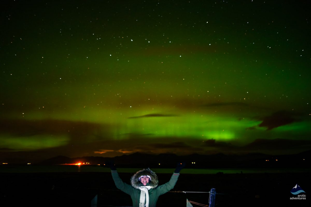Enjoying the Northern Lights on a tour in Iceland