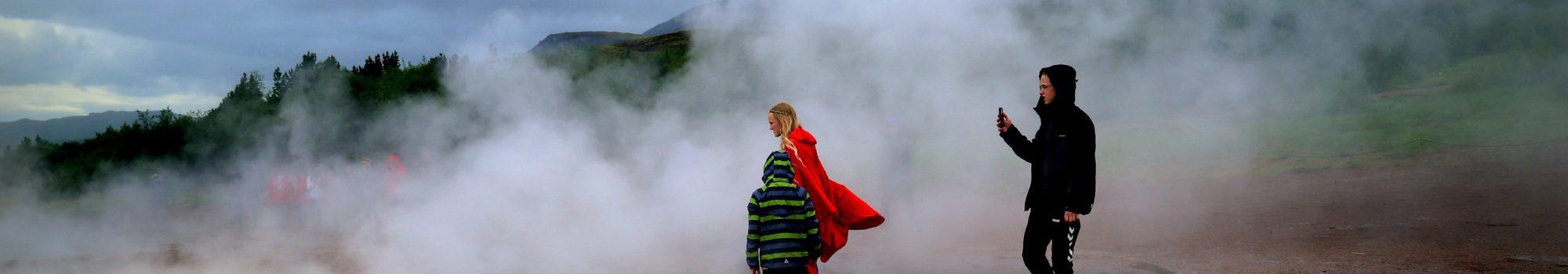 Family at Geysir geyser in Iceland