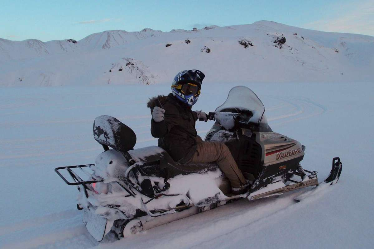 Man riding snowmobile in Iceland