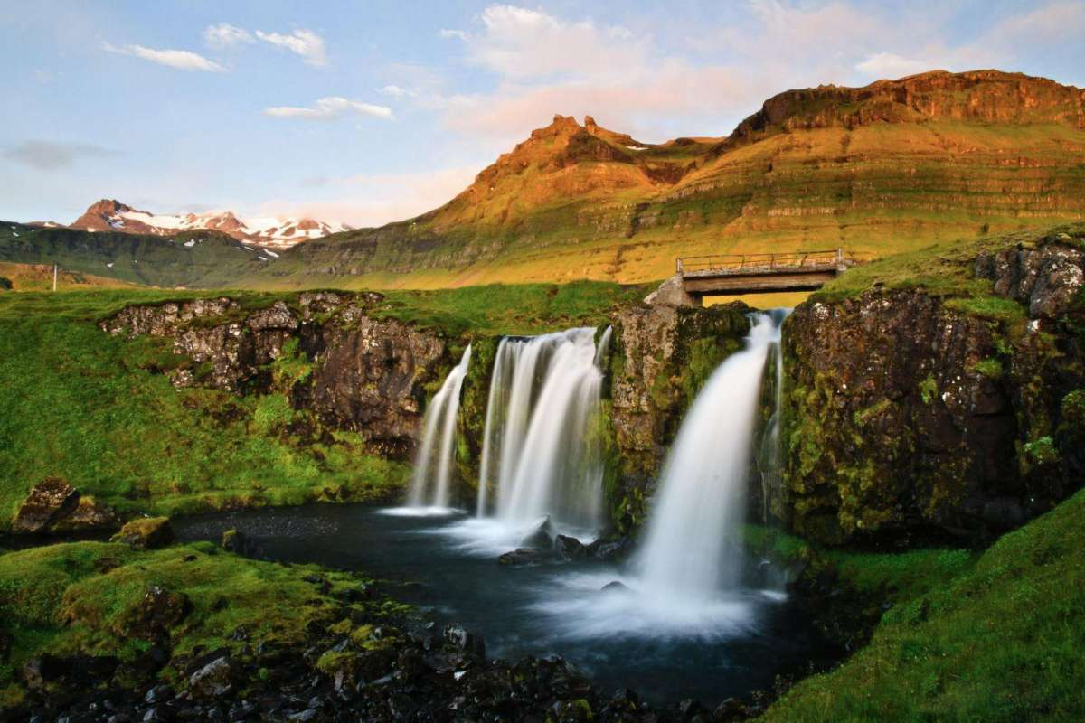 Sunset, bridge over waterfall, Snaefellsnes Iceland