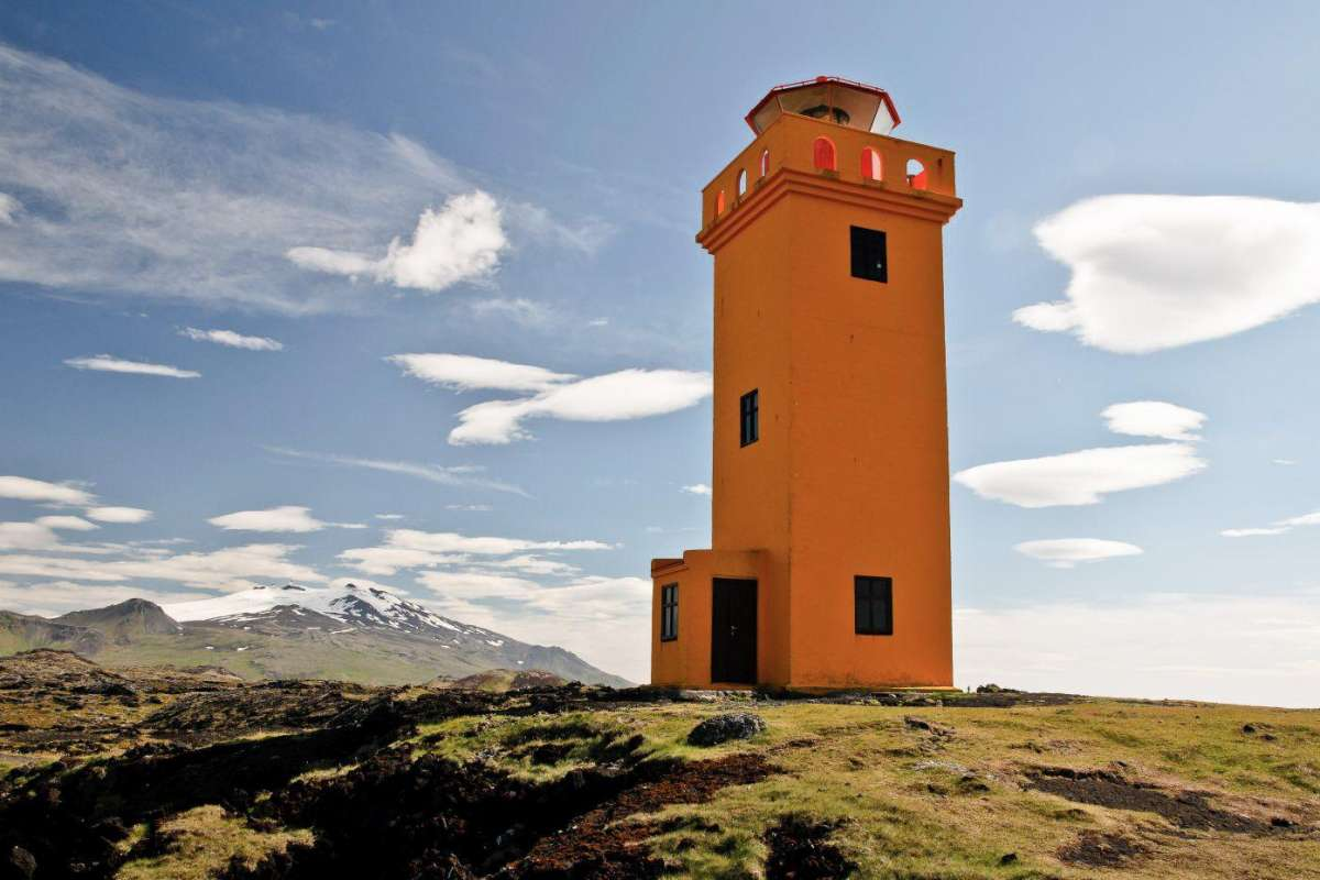 orange lighthouse at snaefellsnes peninsula, iceland