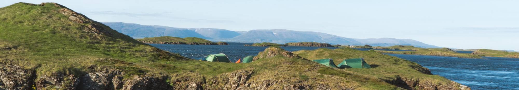three tents on remote island, west iceland