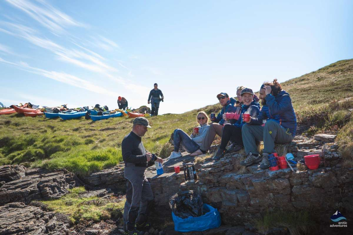 Group of people enjoying sun after kayaking tour in Icekand