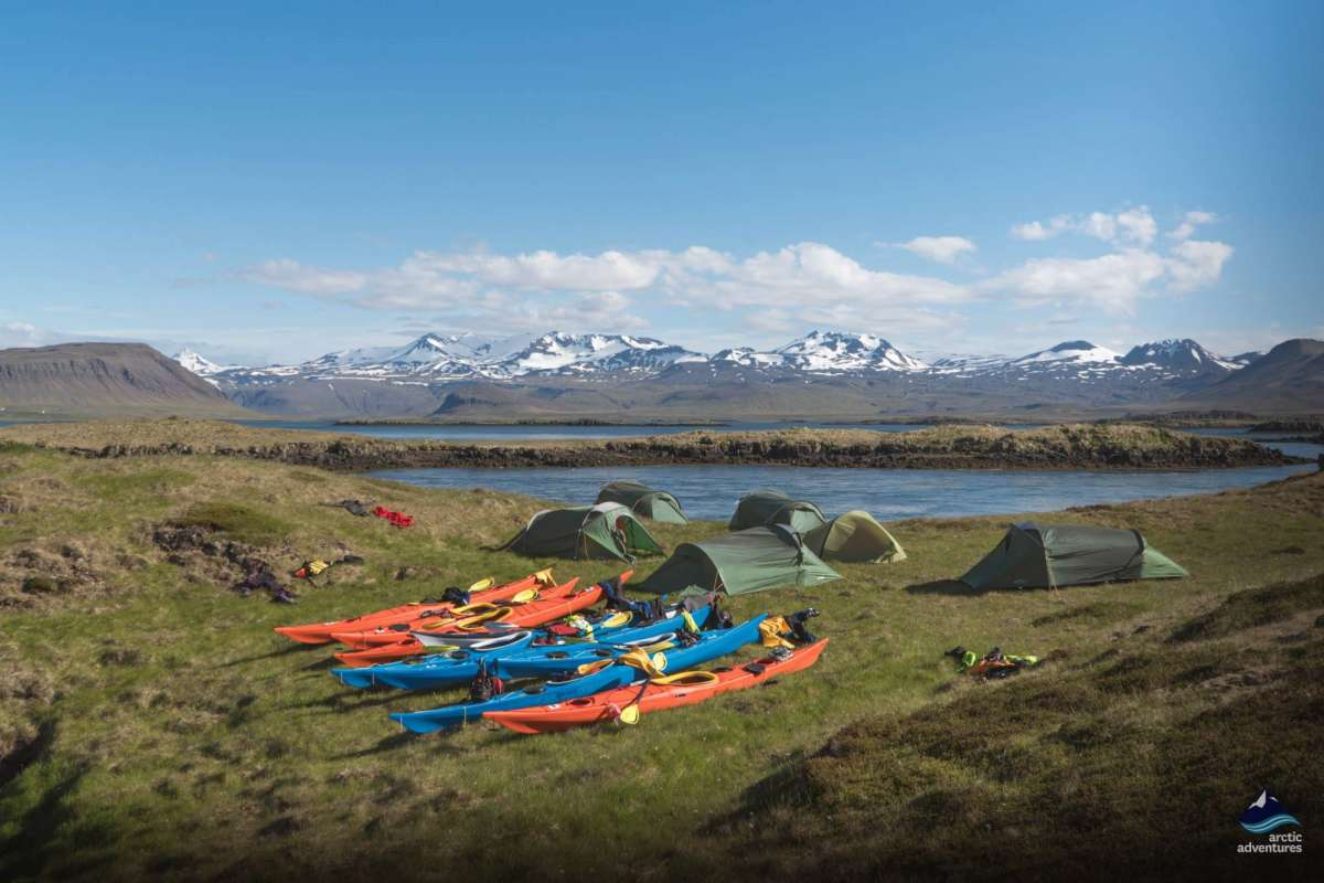 Kayaks in front of tents, iceland