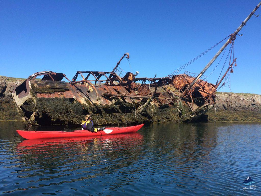 Sea Kayaking Next To Boat Wreck Iceland