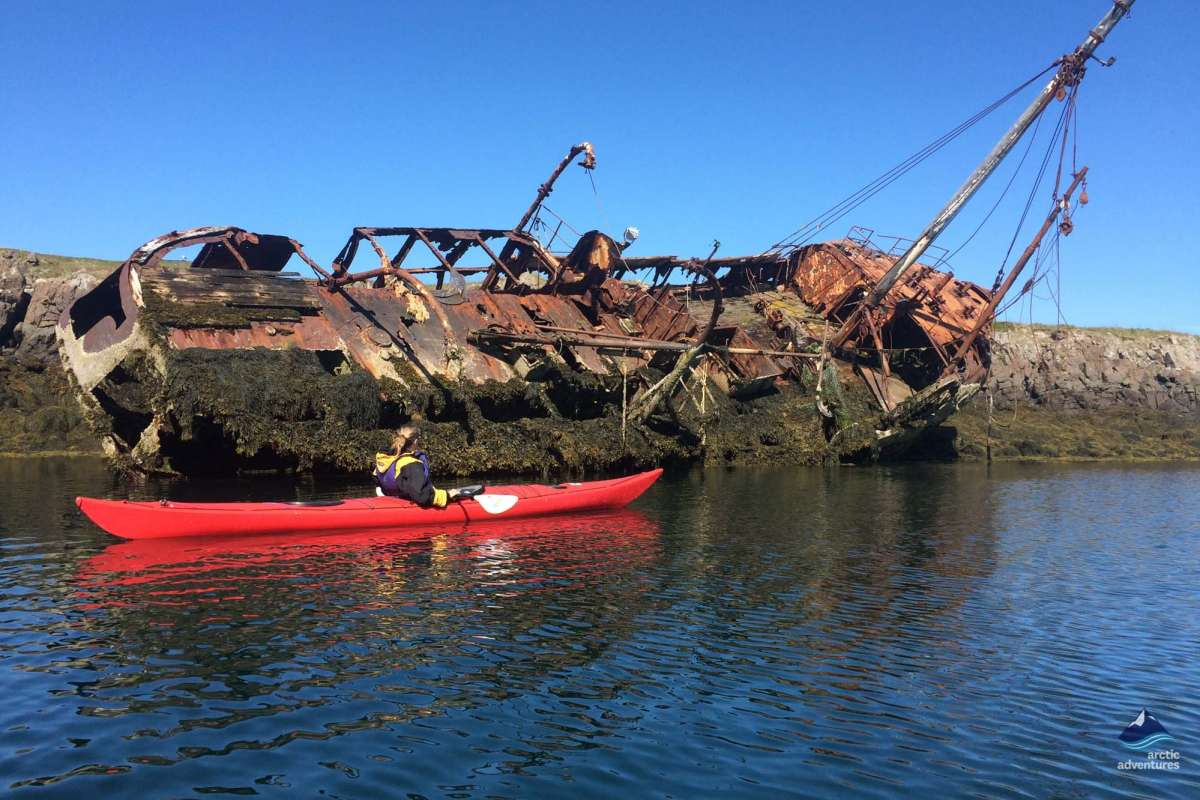 Sea kayaking next to boat wreck Iceland