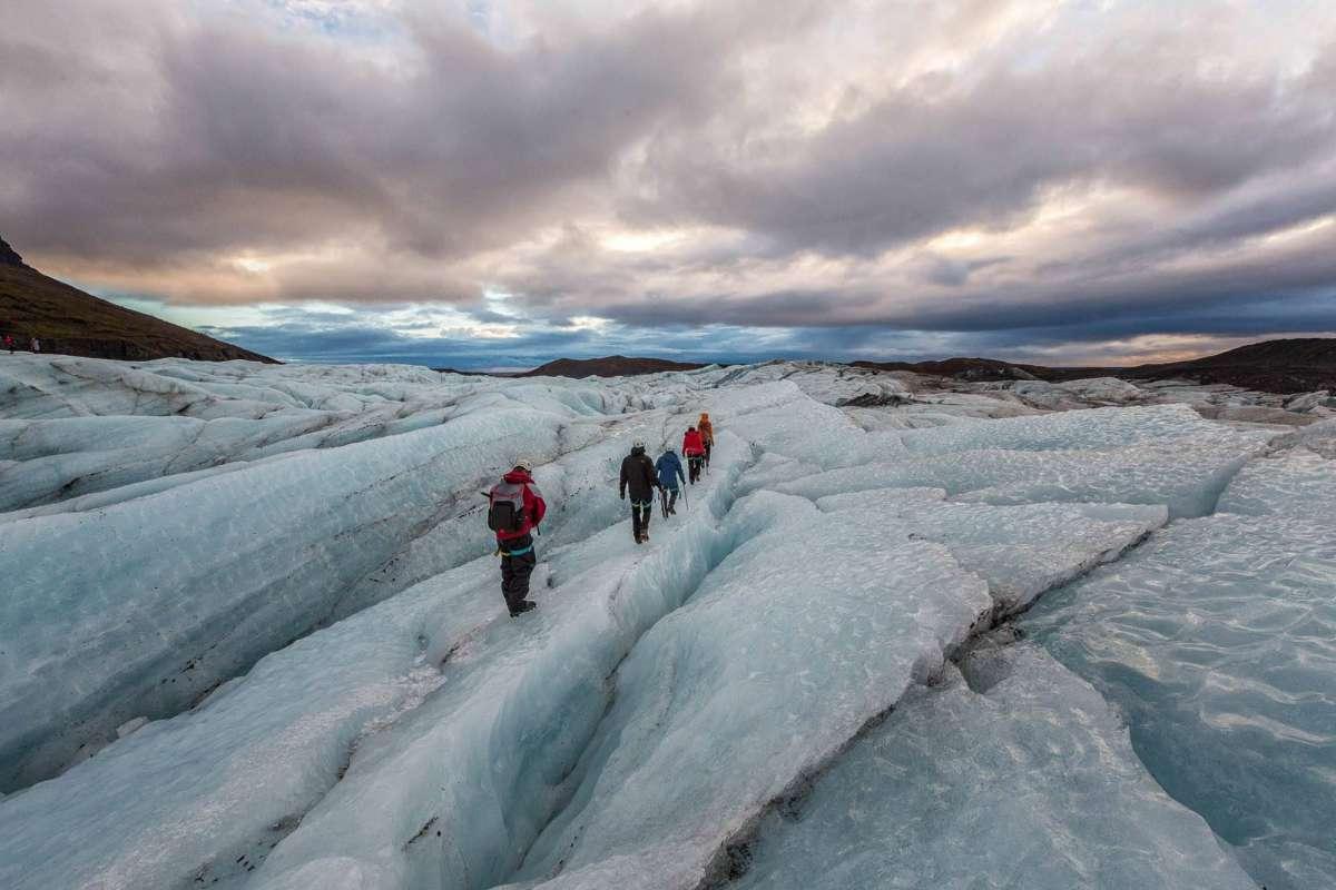 People hiking in Svinafellsjokull glacier