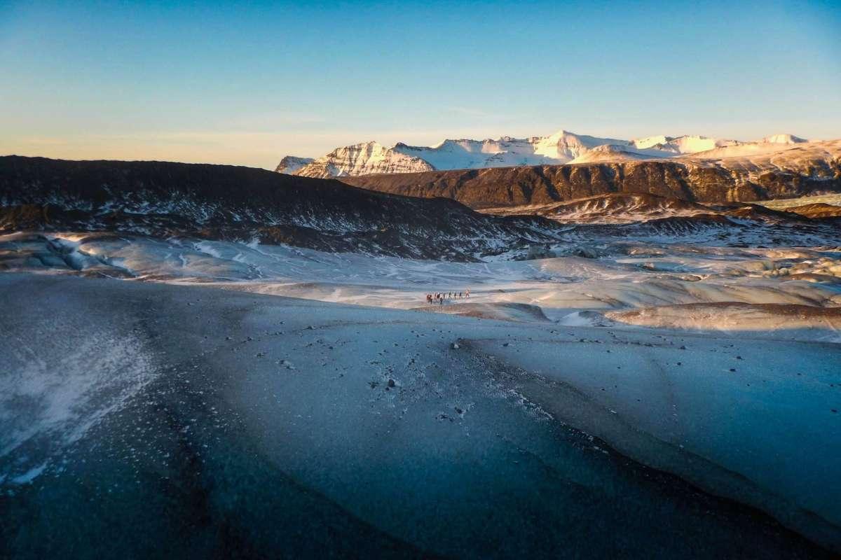people on svinafellsjokull glacier iceland