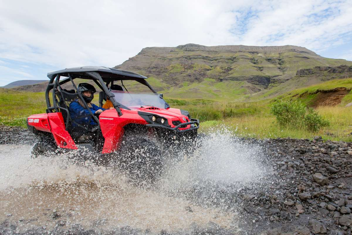 Buggy ride splashing in water in Iceland