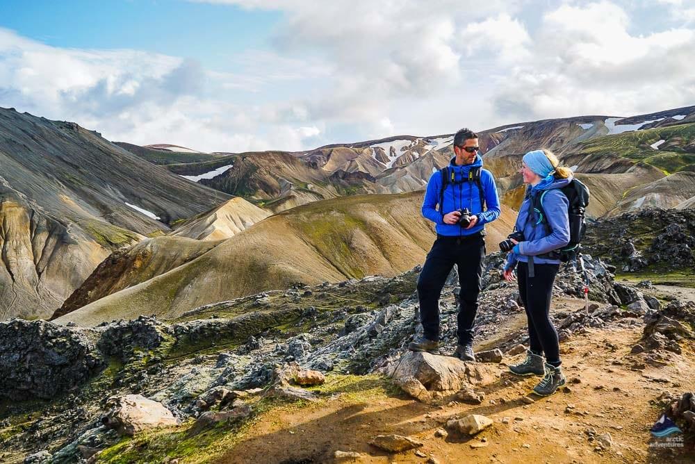 Guide explaining to hiker at Landmannalaugar