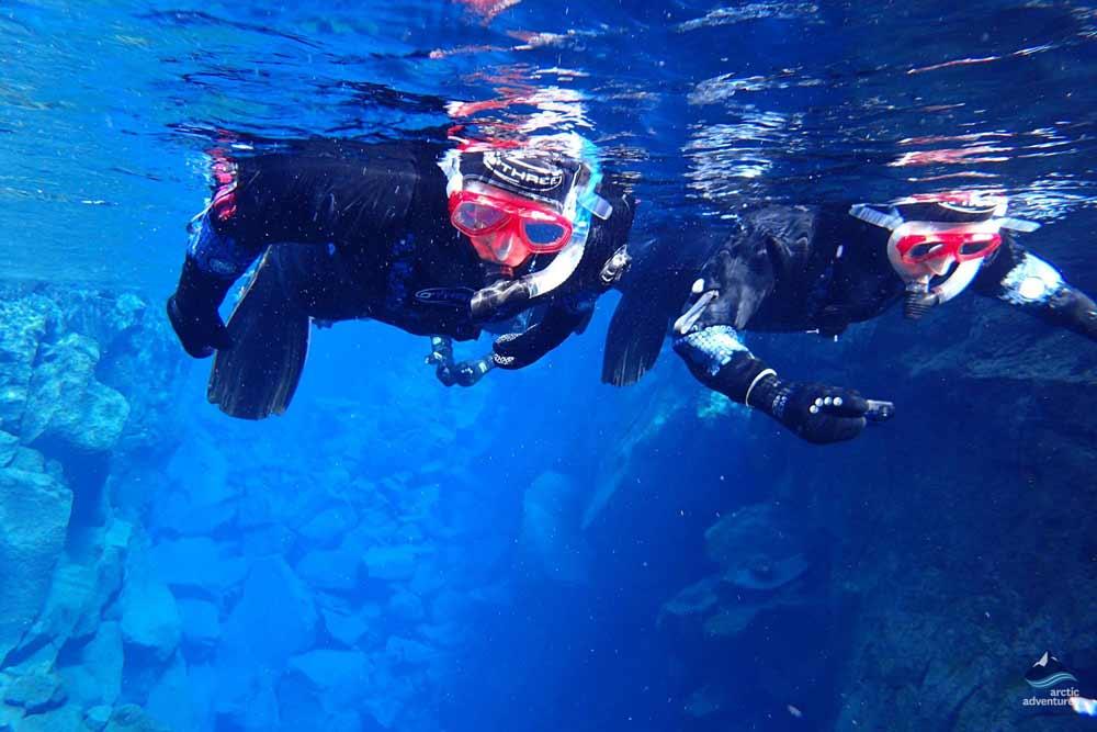 People snorkeling in Silfra
