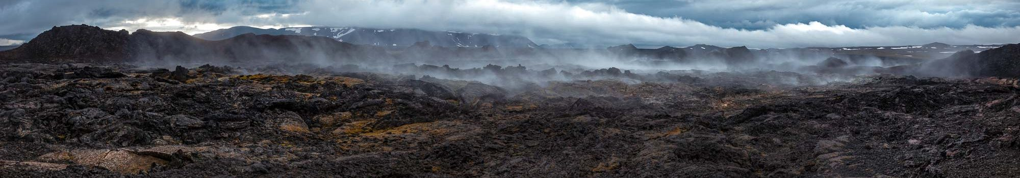 Panoramic view of steaming lava field at Krafla volcanic area