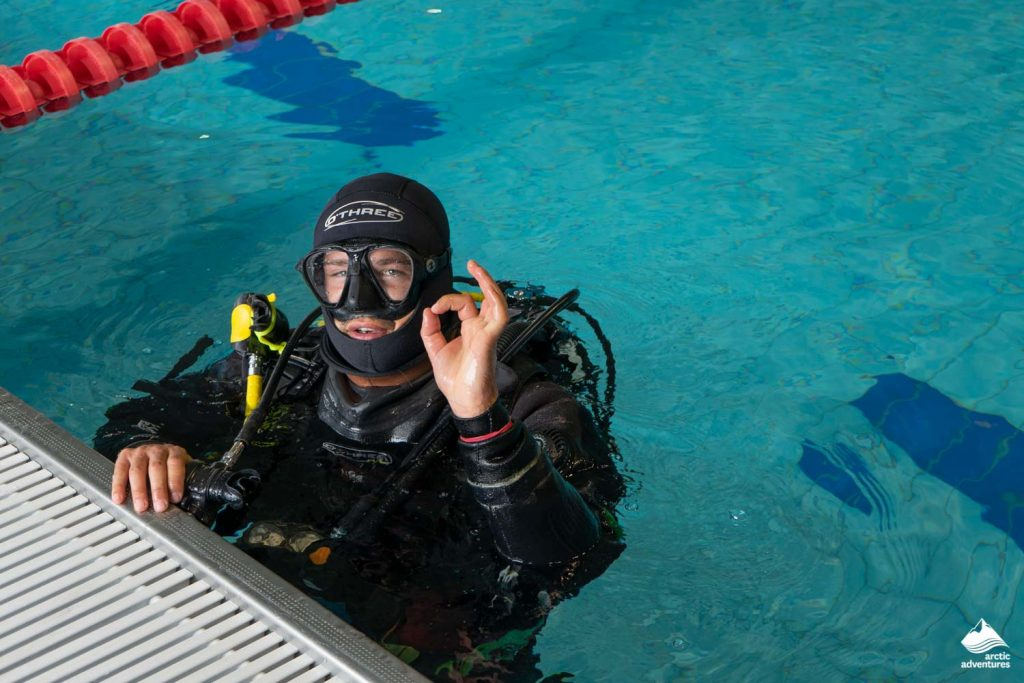 Diver training in swimming pool