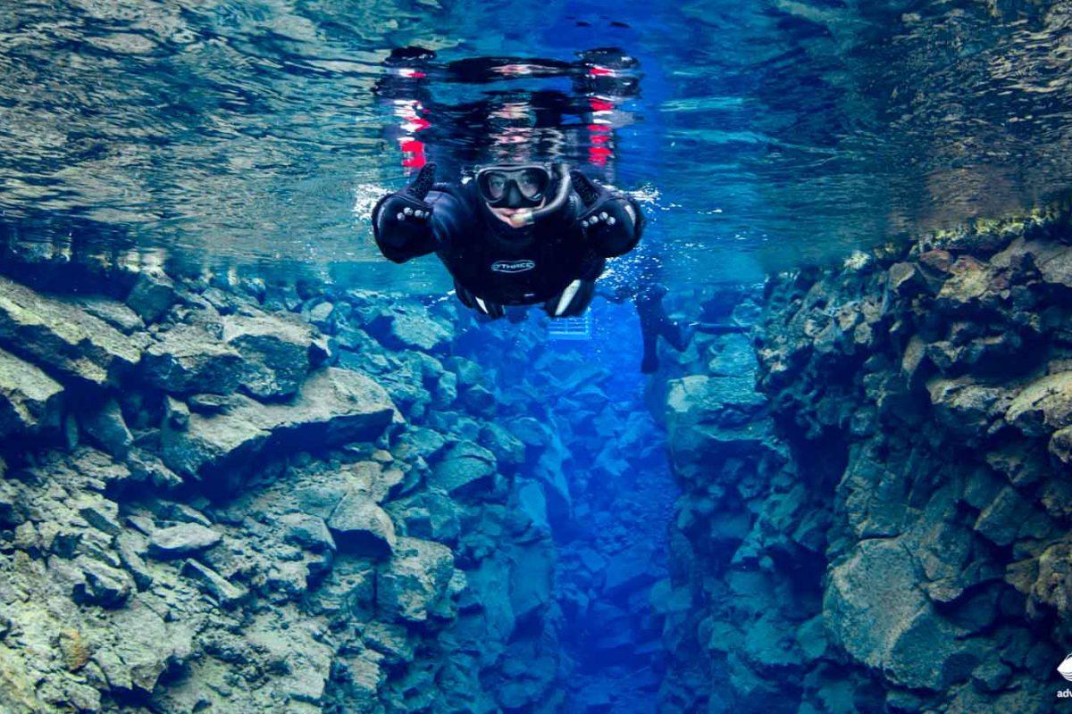 Girl snorkeling in Silfra FIssurea