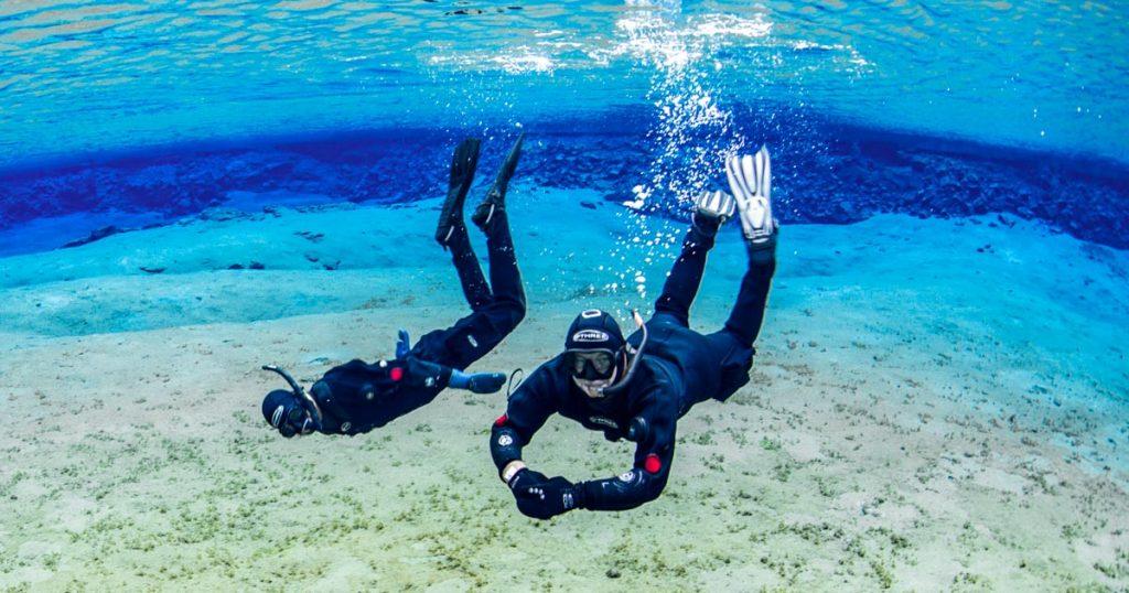 Snorkeling in blue water in SIlfra