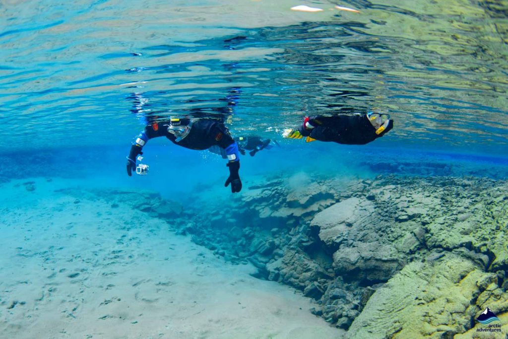Two snorkelers in Silfra