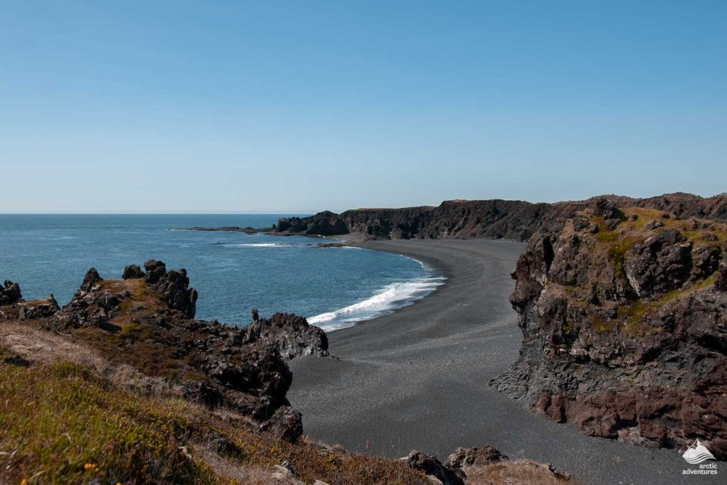 Coastal shot of the black sand covered Djupalonssandur Beach