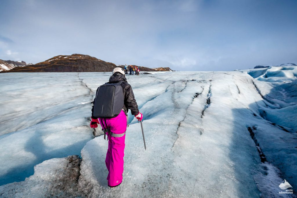 Female hiker walking on glacier at Solheimajokull