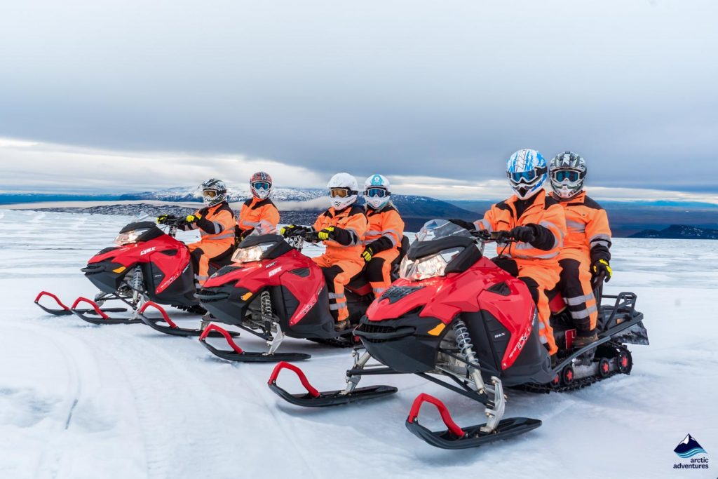 Group of people snowmobile activity